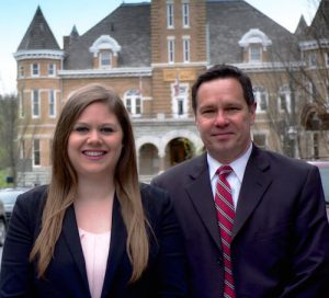 Grace Casteel and John R. Hudson law firm headshot in downtown Fayetteville, Arkansas
